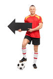 Young football player holding an arrow Royalty Free Stock Image
