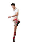 Young football player score goals with raised foot on white back Royalty Free Stock Photos