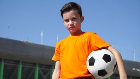The young football player seriously looks at you stock footage