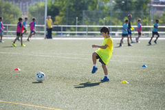 Young football player in a training Stock Photo
