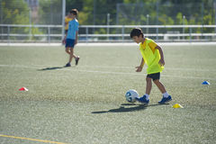 Young football player in a training Stock Photos
