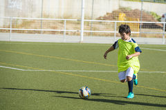 Young football player in a training Royalty Free Stock Photo