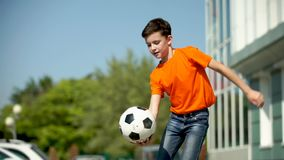 The young football player waves a hand and invites in a game stock footage