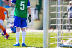 Young football soccer goalkeeper. Young boy as a soccer goalkeeper during football match ready to save Royalty Free Stock Photos