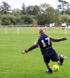 Young Footballer. Teenage footballer kicking a ball stock photos