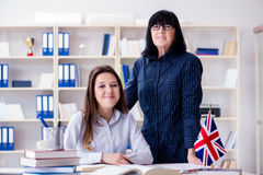 The young foreign student during english language lesson Stock Photography
