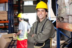 Young Foreman With Arms Crossed At Warehouse Royalty Free Stock Images