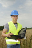 Young foreman with blue helmet Royalty Free Stock Photos