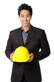 Young foreman or engineer with yellow hard hat in suit isolated Stock Photo
