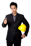 Young foreman or engineer with yellow hard hat suit isolated Royalty Free Stock Photos