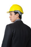 Young foreman or engineer with yellow hard hat in suit isolated Royalty Free Stock Photography