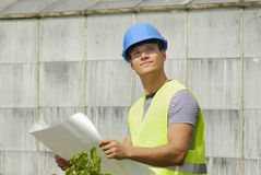 Young foreman with helmet looking up Stock Photos
