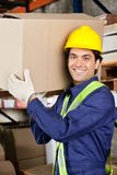Young Foreman Lifting Cardboard Box Royalty Free Stock Photography