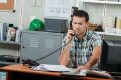 Young foreman on phone Royalty Free Stock Photography