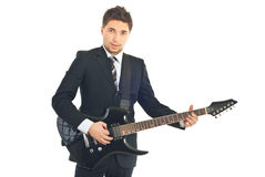 Young formal man with guitar Royalty Free Stock Photos