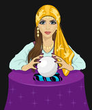 Young fortune teller woman reading future on magical crystal ball. Young fortune teller woman reading future on a magical crystal ball over black backround Stock Photo