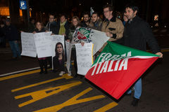Young Forza Italia supporters protesting nearby La Scala opera house in Milan, Italy Stock Photo