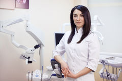 Young freckled woman dentist at her office Stock Image