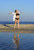 Young free woman at beach. Feeling the wind Royalty Free Stock Photo