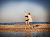Young free woman at beach. Feeling the wind Stock Image