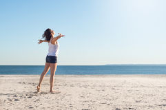 Young freedom woman at beach Stock Photography