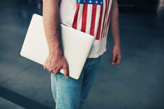 Young freelancer or businessman hands holding close laptop computer. Cropped image university student holding metal color compact notebook in the hand, young Royalty Free Stock Photo
