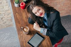 Young freelancer girl is working hard in laptop Stock Images