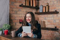 Young freelancer girl is working hard in laptop Stock Image