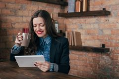Young freelancer girl is working hard in laptop Royalty Free Stock Images