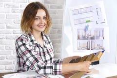 Freelancer interior designer working in design studio. Young freelancer interior designer working develop new appartment project in design studio. Women girl stock image