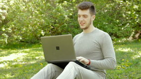 Young freelancer man working with laptop stock footage