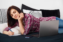 Young freelancer woman using laptop.Happy smiling girl working o Stock Photography