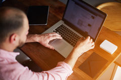 young freelancer working with laptop in home interior Stock Photo