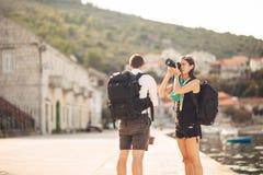Young freelancing photographers enjoying traveling and backpacking.Photojournalism.Documentary travel photos.Lightweight travel. Photography gear,backpack and royalty free stock photo
