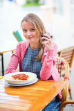 Young French woman having lunch Stock Photos