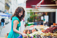 Young French woman on market in Paris Stock Photography