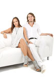 Young fresh european couple on sofa Royalty Free Stock Image