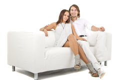 Young fresh european couple on sofa Stock Photos