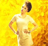 Young fresh lady over the yellow background Royalty Free Stock Photos