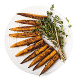 Young fried corn mini with bunch of thyme isolated on white. Several fried cobs of young corn with a bunch of thyme isolated on a white background. Top view stock images