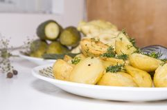Young fried potatoes with pickles and Patison Stock Images