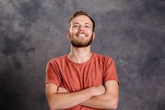 Young friendly, bearded man in red shirt Stock Photography