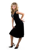 Young friendly blond woman in black dress Royalty Free Stock Photography