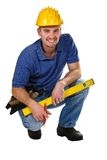 Young friendly crouch manual worker Royalty Free Stock Image