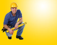 Young friendly crouch manual worker. Background Stock Photography