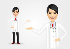Young friendly doctor showing something Royalty Free Stock Image
