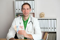 Young friendly family doctor with money Stock Photos