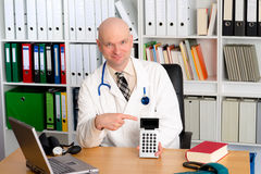 Young friendly family doctor with pocket calculator Stock Image