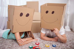 Young friendly family is making fun with packing Royalty Free Stock Image