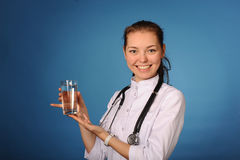 Young friendly female doctor with glass of water Royalty Free Stock Images